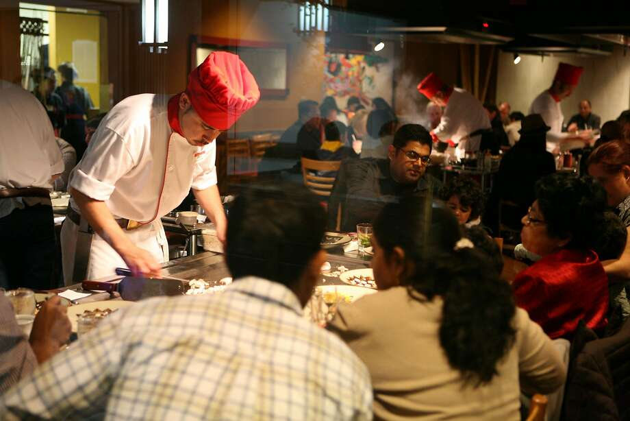 Chefs at Benihana Restaurant entertain while they cook for dinners. Photo by Kat Wade / Special to the Chronicle Photo: Kat Wade