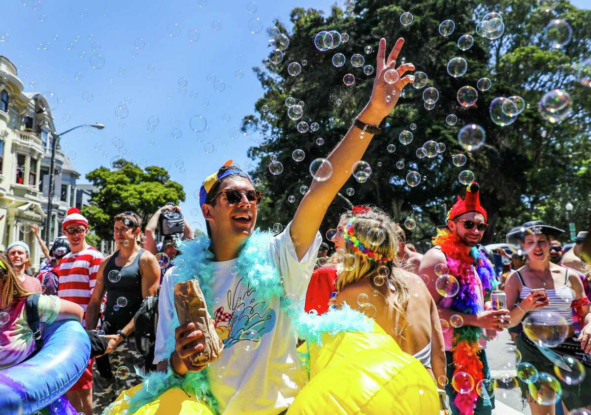 Remi Fernandez plays with bubbles on Fell Street during the 2017 Bay to Breakers. The race has been held since 1912.