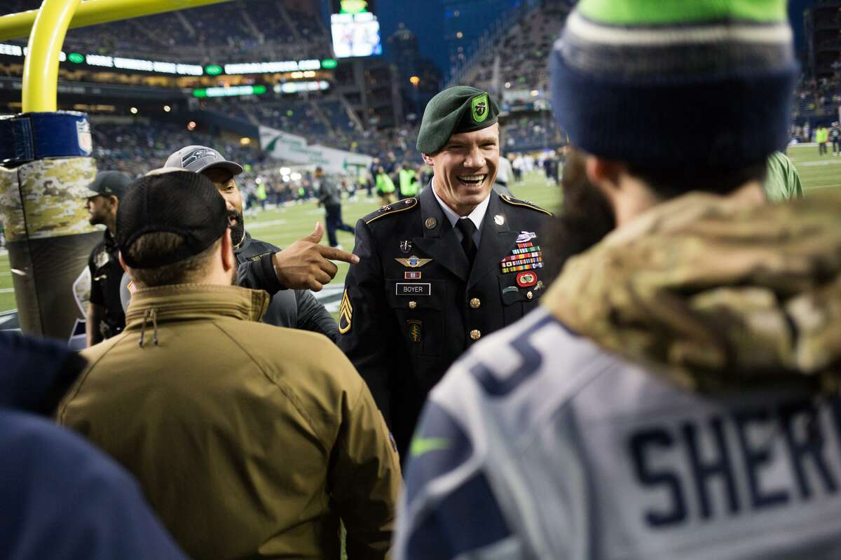 Former Seahawk long-snapper and Green Beret Nate Boyer greets fans and veterans on the sidelines before Seattle takes on Buffalo at CenturyLink Field on Nov. 7, 2016. (GRANT HINDSLEY, seattlepi.com)