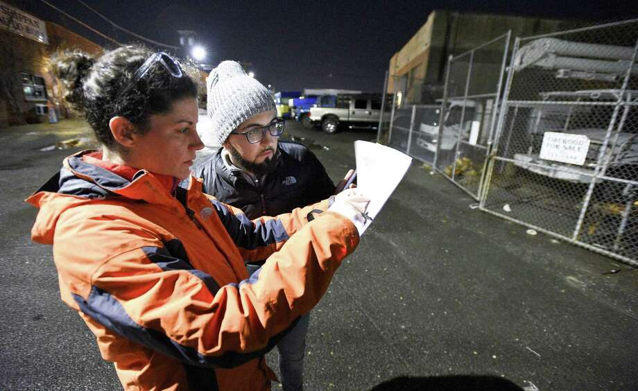 Micaela Marshall and Emmanuel Silva De Sousa check the Shippan business district during the annual point-in-time homeless count in Stamford, Conn. on Tuesday, Jan. 23, 2018. Photo: Matthew Brown / Hearst Connecticut Media / Stamford Advocate