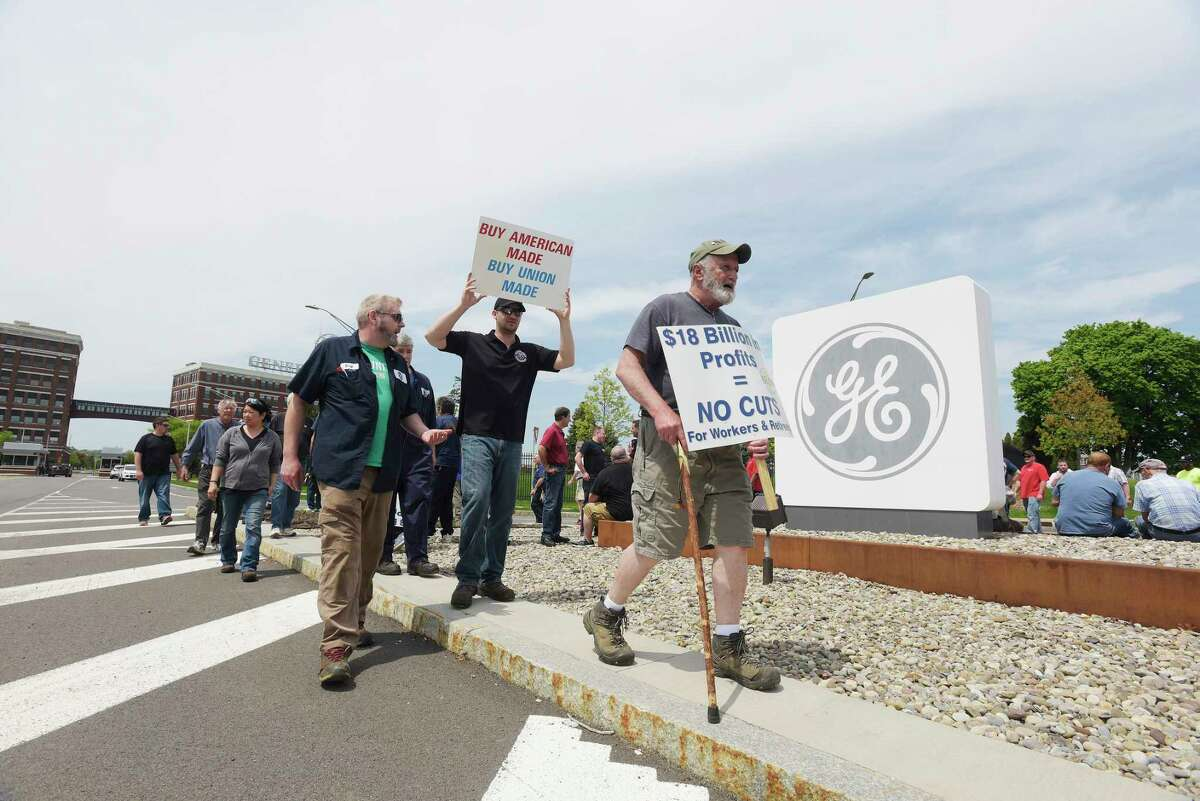 IUE-CWA Local 301 union members and retirees take part in a protest outside the gates of General Electric on Thursday, May 17, 2018, in Schenectady, N.Y. Retirees say that they are unfairly seeing benefits taken away year after year by General Electric after decades of working for the company. (Paul Buckowski/Times Union)