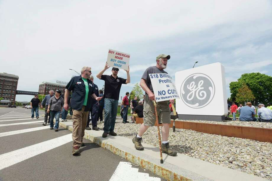 IUE-CWA Local 301 union members and retirees take part in a protest outside the gates of General Electric on Thursday, May 17, 2018, in Schenectady, N.Y. Retirees say that they are unfairly seeing benefits taken away year after year by General Electric after decades of working for the company.   (Paul Buckowski/Times Union) Photo: PAUL BUCKOWSKI / (Paul Buckowski/Times Union)