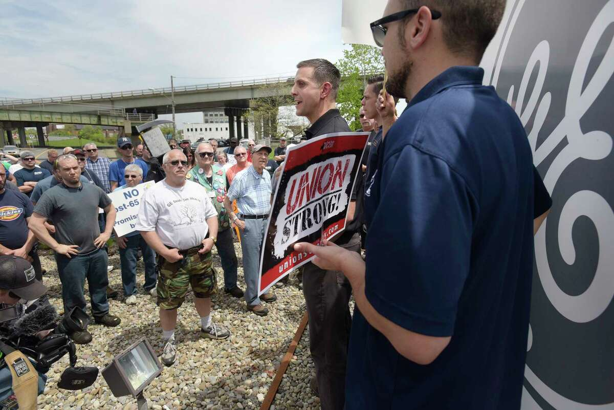 Bob Macherone, business agent for IUE-CWA Local 301, addresses union members and retirees as they hold a protest outside the gates of General Electric on Thursday, May 17, 2018, in Schenectady, N.Y. Retirees say that they are unfairly seeing benefits taken away year after year by General Electric after decades of working for the company. (Paul Buckowski/Times Union)