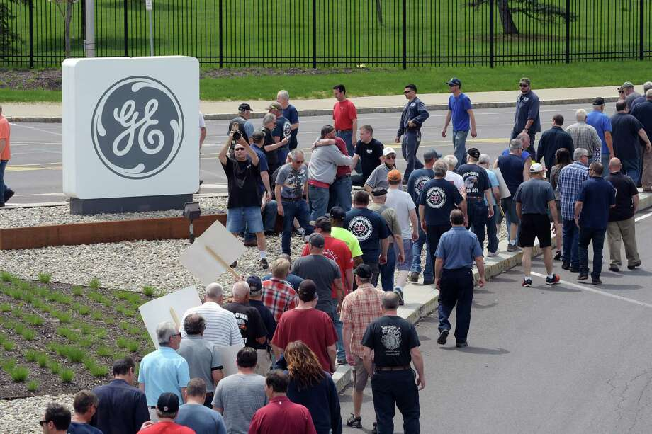 FILE — IUE-CWA Local 301 union members and retirees take part in a protest outside the gates of General Electric on Thursday, May 17, 2018, in Schenectady, N.Y. Retirees say that they are unfairly seeing benefits taken away year after year by General Electric after decades of working for the company.   (Paul Buckowski/Times Union) Photo: PAUL BUCKOWSKI / (Paul Buckowski/Times Union)