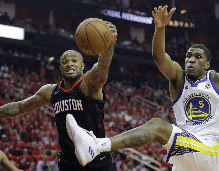 "Houston Rockets forward P.J. Tucker, left, is the key to the Rockets' smallball ""Tuckwagon"" lineup. Photo: David J. Phillip / Associated Press"