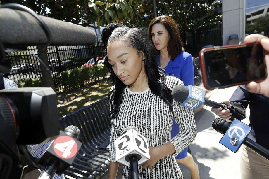 Elissa Ennis, former girlfriend of San Francisco 49ers linebacker Reuben Foster, center, walks out of Santa Clara County Superior Court with her attorney Stephanie Rickard, rear, after testifying in Foster's preliminary hearing, Thursday, May 17, 2018, in San Jose, Calif. Foster pleaded not guilty Tuesday, May 8, 2018, to charges stemming from allegations that he attacked Ennis in their home in February. (AP Photo/Marcio Jose Sanchez) Photo: Marcio Jose Sanchez / Associated Press