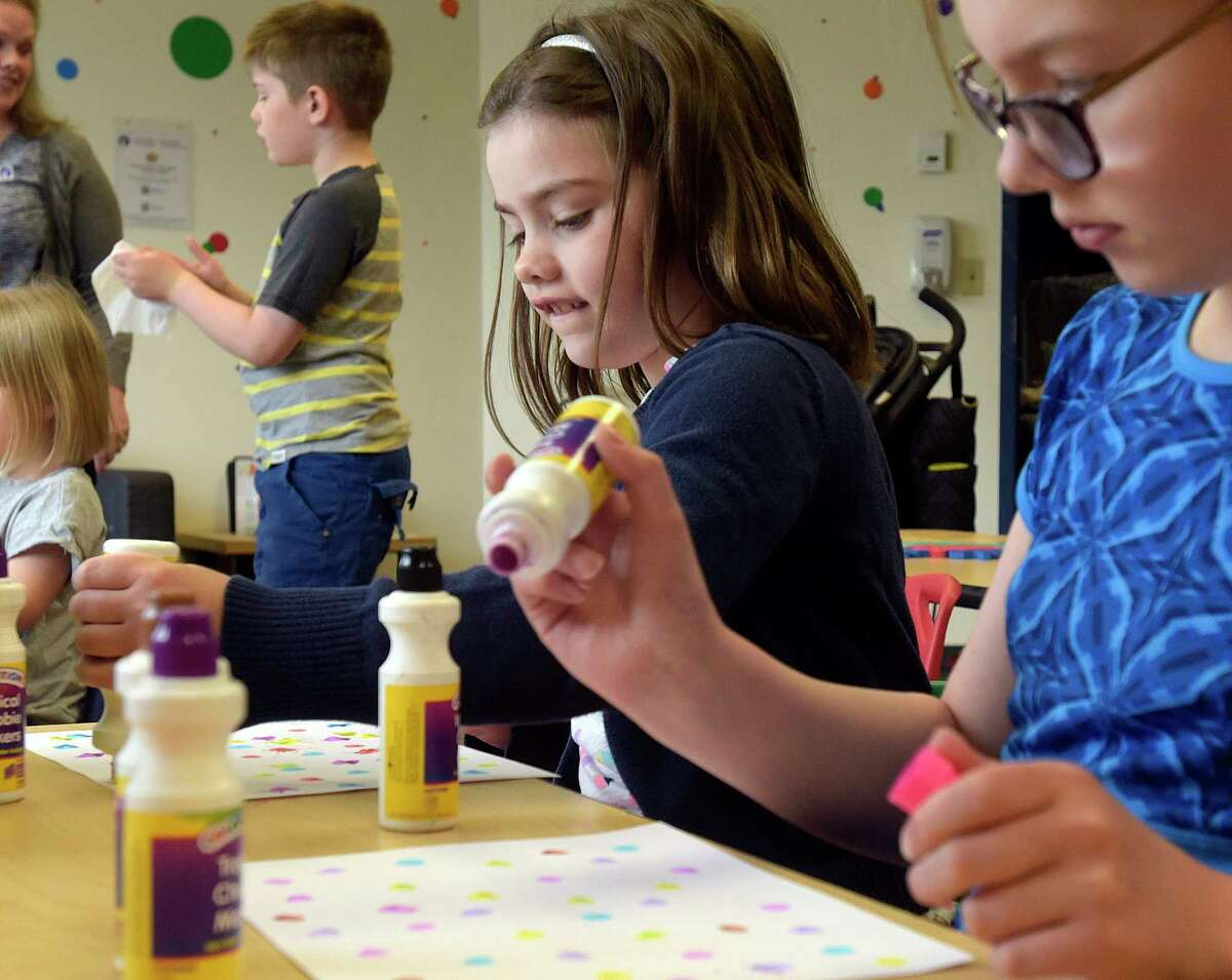 Lucy Thompson, 7, creates artwork using colored dots during the Science Story Time program at the Children's Museum of Science and Technology on Wednesday, May 16, 2018, in Troy, N.Y. The book The Dot by Peter Reynolds was read to the children and then they created their own artwork. Every Wednesday at 11:00am the museum has the Science Story Time program. Every Thursday at 10:00am the museum has their Sensory Play program and every Friday at 11:00am the museum has their Investigate the A in STEaM program, a creative arts activity. (Paul Buckowski/Times Union)