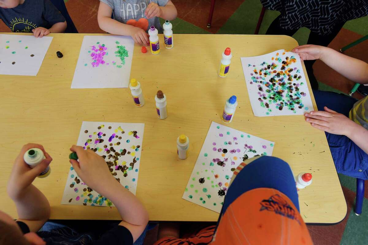 Children create artwork out of colored dots during the Science Story Time program at the Children's Museum of Science and Technology on Wednesday, May 16, 2018, in Troy, N.Y. The book The Dot by Peter Reynolds was read to the children and then they created their own artwork. Every Wednesday at 11:00am the museum has the Science Story Time program. Every Thursday at 10:00am the museum has their Sensory Play program and every Friday at 11:00am the museum has their Investigate the A in STEaM program, a creative arts activity. (Paul Buckowski/Times Union)