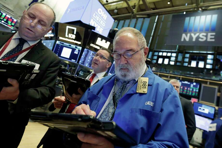 Traders Gordon Charlop, Edward Curran and Eugene Mauro, left to right, work on the floor of the New York Stock Exchange, Thursday, May 17, 2018. U.S. stocks edged higher in morning trading Thursday, having shaken off an early stumble, as investors weighed the latest batch of company earnings news. (AP Photo/Richard Drew) Photo: Richard Drew / AP