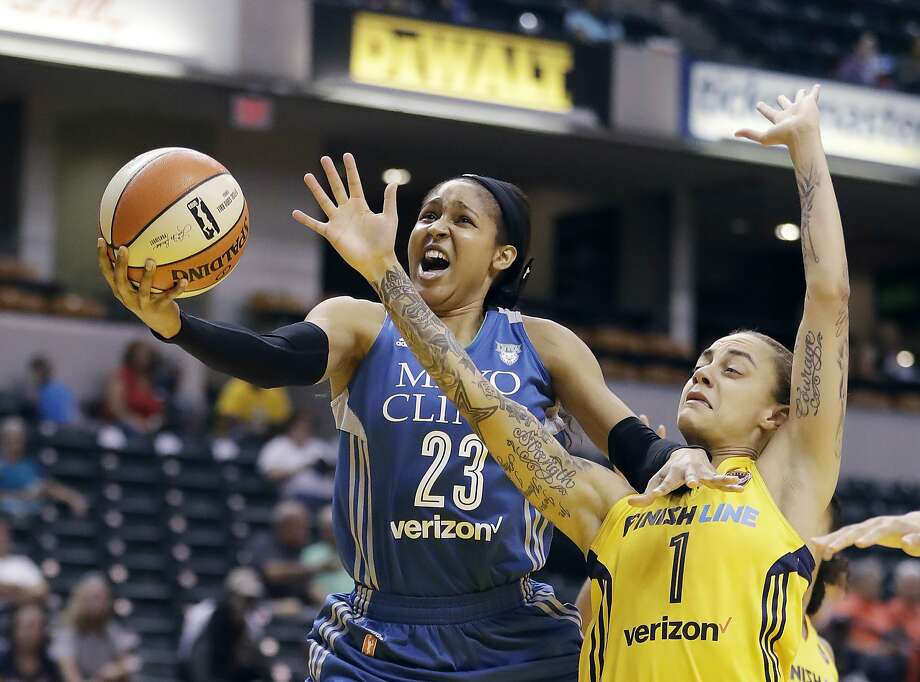 FILE - In this Aug. 30, 2017, file photo, Minnesota Lynx's Maya Moore, left, shoots against Indiana Fever's Jazmon Gwathmey during the first half of a WNBA basketball game in Indianapolis. The defending champion Minnesota Lynx begin the season atop The Associated Press WNBA poll. The Lynx received nine first-place votes from the 14-person national media panel Thursday, May 17, 2018. (AP Photo/Darron Cummings, File) Photo: Darron Cummings, Associated Press