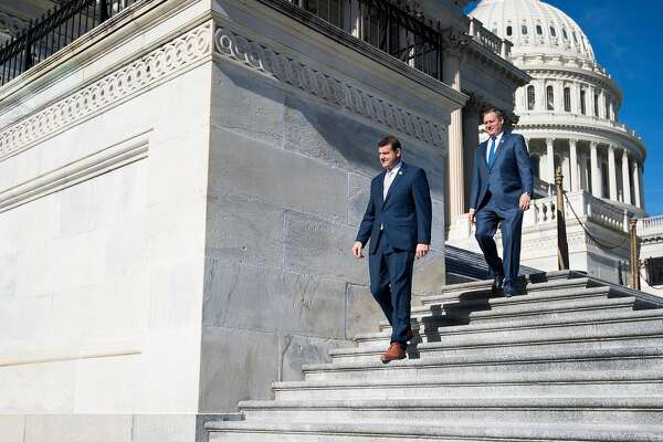 UNITED STATES - JANUARY 19: Rep. David Valadao, R-Calif.,, left, and Rep. Jeff Denham, R-Calif., walk down the House steps following the final scheduled votes of the week on Friday, Jan. 19, 2018. House members were told to stay flexible on their schedule as efforts to avoid a government shutdown continued in Washington. (Photo By Bill Clark/CQ Roll Call)