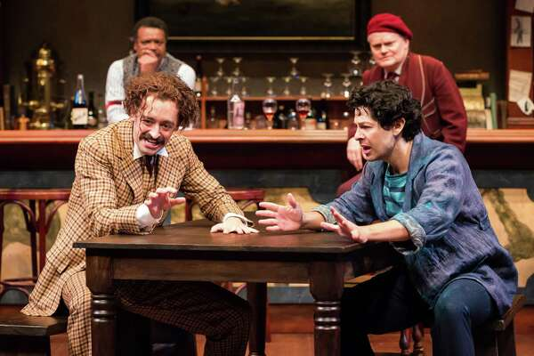 """Shawn Hamilton, left, as Freddy, Dylan Godwin as Albert Einstein, Joseph Castillo-Midyett as Pablo Picasso and Torrey Hanson as Gaston in the Alley Theatre's production of """"Picasso at the Lapin Agile,"""" by Steve Martin."""