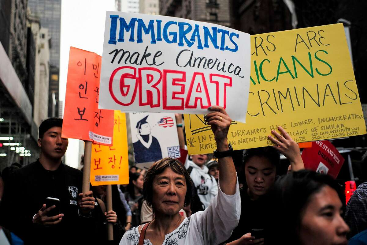 This 2017 file photo shows protesters with signs during a demonstration against President Trump and in support of the Deferred Action for Childhood Arrivals. On Monday, Nov. 5, Trump asked the U.S. Supreme Court to bypass lower courts and rule on DACA.
