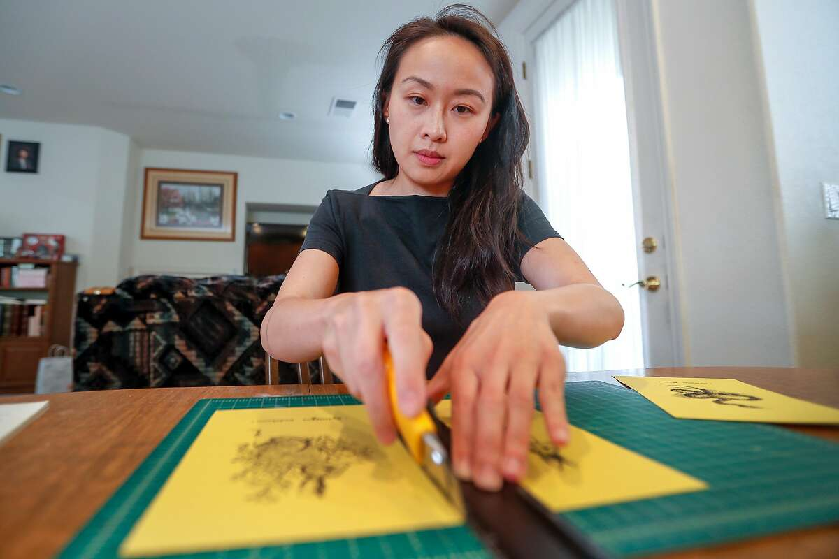 Tiffany Lin works on some of her illustration at her parents home in Cupertino, California, Thursday, May 17, 2018. Tiffany Lin is a part-time art teacher and artist who gets her Kaiser health insurance through Covered California. She pays just $1 a month in premiums, but her co-pays are high -- $75 for many types of doctors' visits, and $100 for some prescriptions.