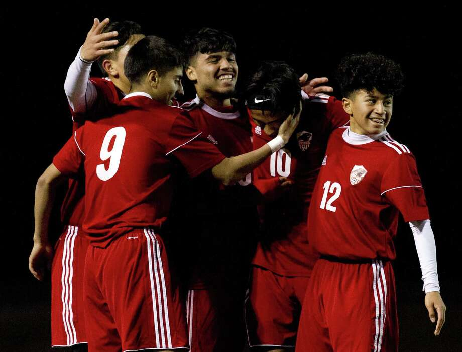 Caney Creek's Omar Quintana celebrates with teammates after scoring a goal in the first period of a match during the Willis Wildkat Showcase at Lynn Lucas Middle School, Thursday, Jan. 4, 2018, in Willis. Photo: Jason Fochtman, Staff Photographer / Houston Chronicle / © 2018 Houston Chronicle