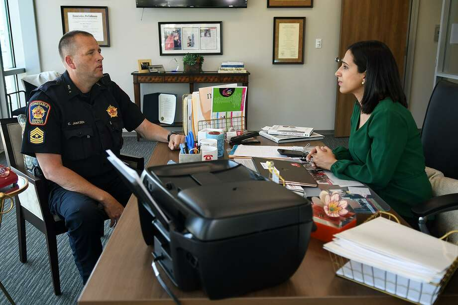 Harris County Constabl'e Office Precinct 5 Sergeant Charles Jantzen, left, of the Animal Crimes unit, talks strategy with Crime Stoppers Executive Director Rania Mankarious at the Crime Stoppers of Houston building in Houston on May 16. Photo: Jerry Baker, Freelance / For The Chronicle / Freelance