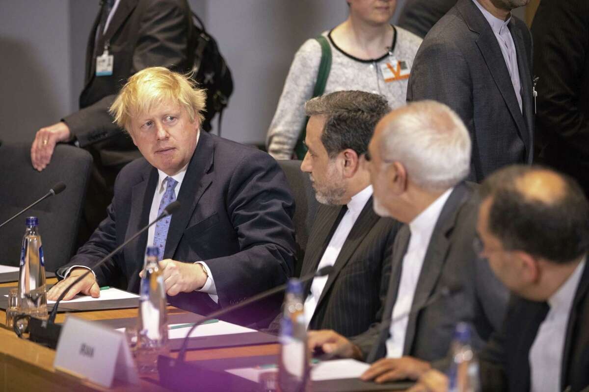 British Foreign Secretary Boris Johnson, looks at Iranian Foreign Minister Javad Zarif, second right, during a meeting of the foreign ministers from Britain, France and Germany with the Iran Foreign Minister and EU foreign policy chief Federica Mogherini, at the Europa building in Brussels, Tuesday. Major European powers sought to keep Iran committed to a deal to prevent it from building a nuclear bomb despite President Trump's withdrawal from the aggreement.