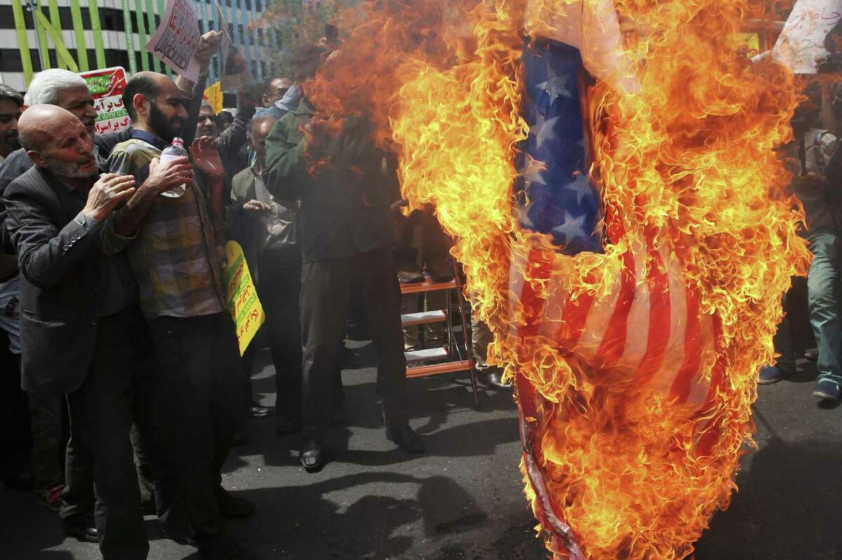 Why the outrage? In withdrawing from the Iran nuclear deal, President Trump is simply doing what he said he would do. Iranian protestors burn a representation of a U.S. flag during a gathering after their Friday prayer in Tehran, Iran, May 11.