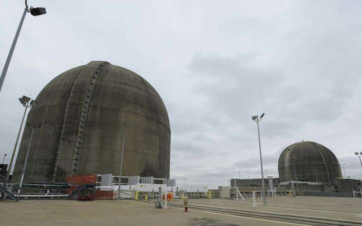 Reactive domes of the South Texas Project nuclear power plant sit under an overcast sky on Friday, Dec. 6, 2013.