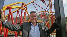 Six Flags Fiesta Texas president Jeffrey Siebert poses in front of Wonder Woman ride on Monday, May 14, 2018.