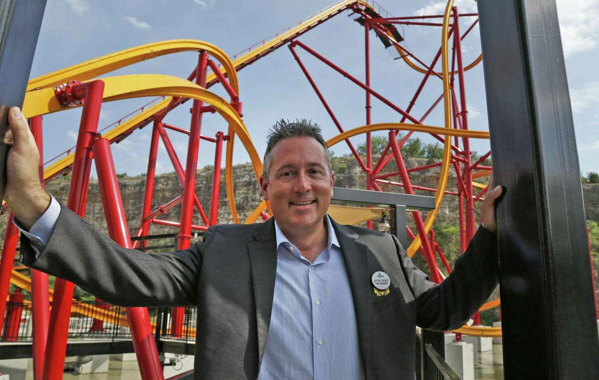 Six Flags Fiesta Texas President Jeffrey Siebert poses in front of the Wonder Woman Golden Lasso Coaster, the first roller coaster to take its theme from the iconic DC Comics character.