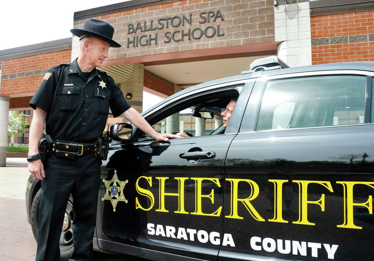 Saratoga County Sheriff director of community preparedness and youth services, Deputy Ken Cooper, left, speaks with Deputy Biagio Guida outside Ballston Spa High School Thursday May 17, 2018 in Ballston Spa, NY. Seven county schools have signed up to have trained and armed resource officers walk their corridors. (John Carl D'Annibale/Times Union)
