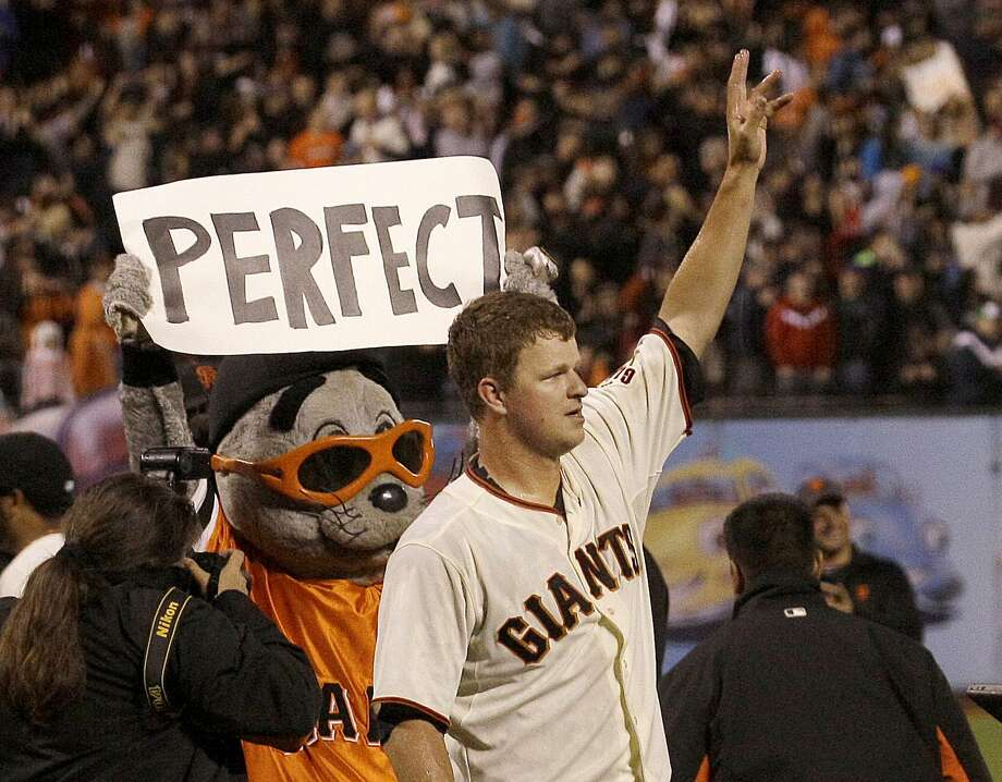 San Francisco Giants pitcher Matt Cain celebrates after the final out of the ninth inning of a baseball game against the Houston Astros in San Francisco, Wednesday, June 13, 2012. Cain pitched the 22nd perfect game in major league history and first for the Giants, striking out a career-high 14 and getting help from two spectacular catches to beat the Houston Astros 10-0. Photo: Jeff Chiu / Associated Press / ONLINE_YES