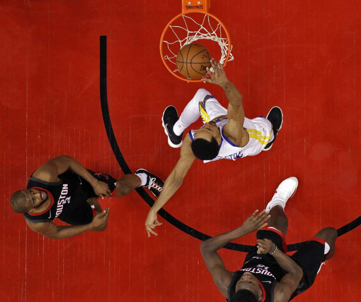 Shaun Livingston (34) dunks past Chris Paul (3) and Clint Capela (15) in the first half as the Golden State Warriors played by the Houston Rockets in Game 2 of the Western Conference Finals at Toyota Center in Houston, Texas, on Wednesday, May 16, 2018. The Rockets won 127-105.