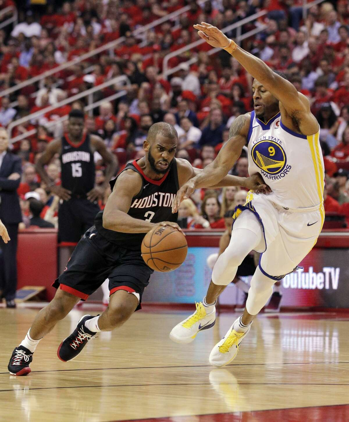Chris Paul (3) drives to the basket against Andre Iguodala (9) in the second half as the Golden State Warriors played by the Houston Rockets in Game 2 of the Western Conference Finals at Toyota Center in Houston, Texas, on Wednesday, May 16, 2018. The Rockets won 127-105.
