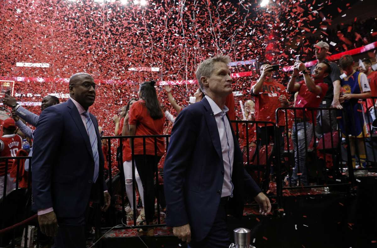 Warriors head coach Steve Kerr, right, walks off the court with assistant coach Mike Brown after the Golden State Warriors were defeated by the Houston Rockets 127-105 in Game 2 of the Western Conference Finals at Toyota Center in Houston, Texas, on Wednesday, May 16, 2018.