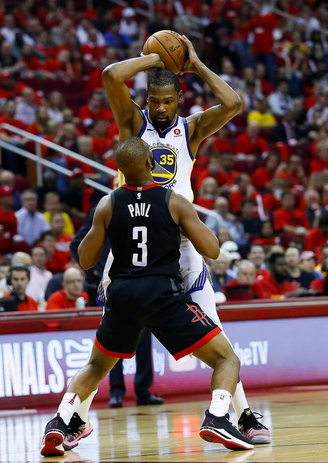 Houston Rockets guard Chris Paul (3) defends Golden State Warriors forward Kevin Durant (35) during the second half of Game 2 of the Western Conference Finals at the Toyota Center, Wednesday, May 16, 2018, in Houston. ( Michael Ciaglo  / Houston Chronicle ) Photo: Michael Ciaglo / Houston Chronicle