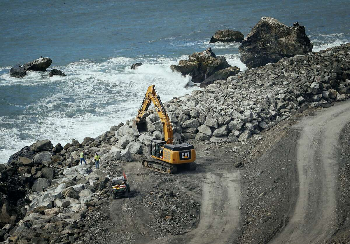 In a March. 8, 2018 photo, crews work to finish up the massive seawall at the base of the Mud Creek Slide on the Big Sur Coast of Calif. Highway 1 has been dogged by slides since December 2016, but the one that hit at Mud Creek near Ragged Point in May 2017 was monumental. (Joe Johnston /The Tribune (of San Luis Obispo) via AP)