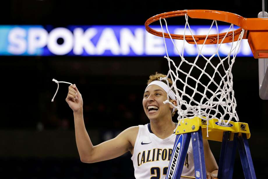 Cal's Layshia Clarendon holds up a piece of the net after the Bears beat Georgia in overtime in a 2013 NCAA Tournament regional final in Spokane, Wash. Photo: Elaine Thompson / Associated Press 2013