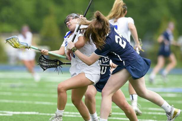 Darien's Nicole Humphrey (1) collides with Staples' Kyle Kirby (24) in a FCIAC girls lacrosse quarterfinal game at Darien High School in Darien, Conn. on May 16, 2017. Darien defeated Staples 18-6.