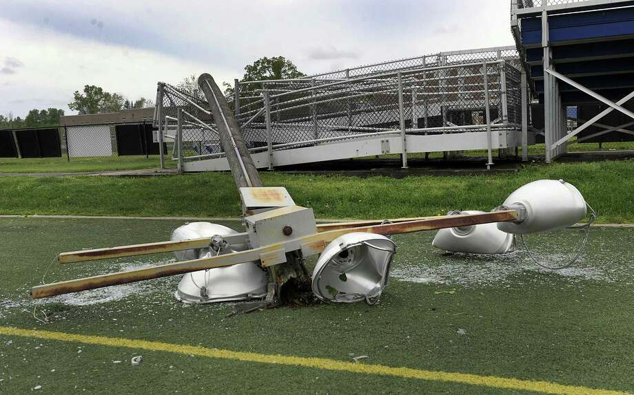 The athletic complex at Brookfield High School took a major hit in the storm that blew through on Tuesday.  Included in the damage is smashed light poles and fixtures. Photo Thursday, May 17, 2018. Photo: Carol Kaliff / Hearst Connecticut Media / The News-Times