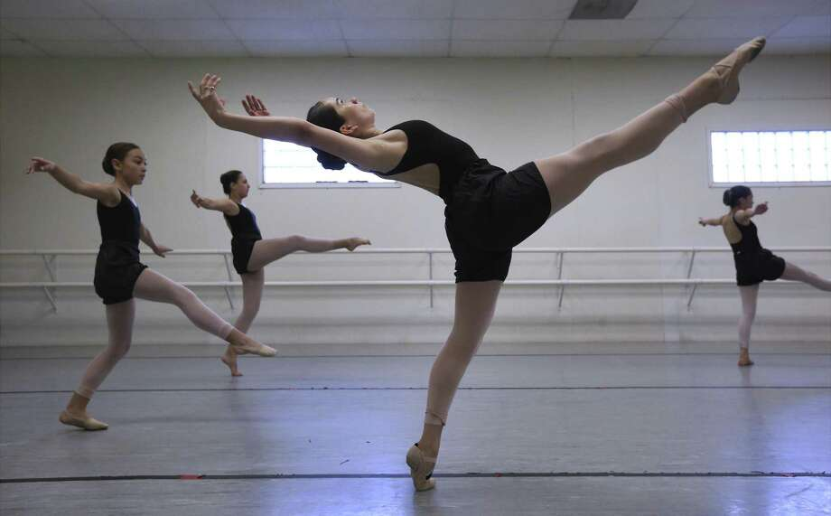 Rowan Casillas, in front, is a 17-year-old dancer and choreographer with the San Antonio Metropolitan Ballet who has created a piece that links thematically to schizophrenia. She was inspired by her family's history with the mental disorder to create the dance. The month of May is Mental Health Awareness Month. Photo: Kin Man Hui /San Antonio Express-News / ©2018 San Antonio Express-News