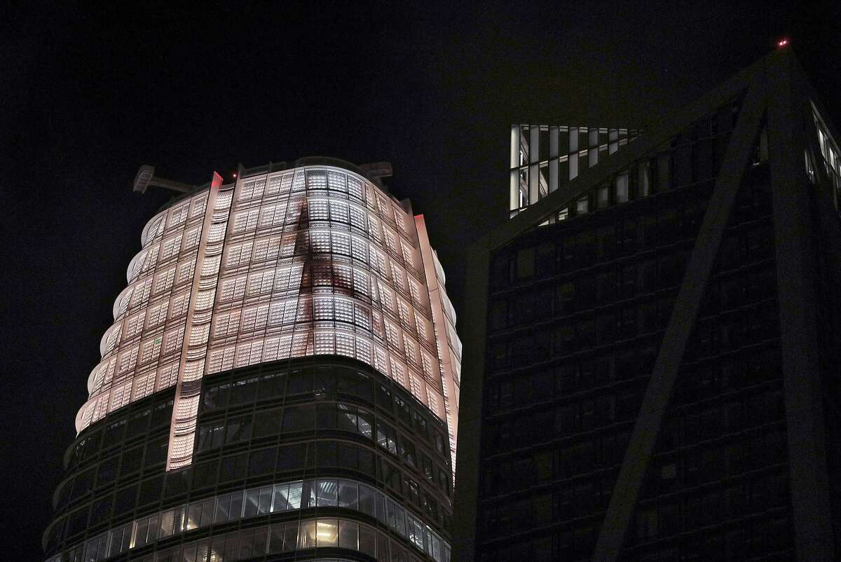 The image of a dancer is visible on the Saleforce Tower crown as part of a light sculpture created by famed light artist Jim Campbell in San Francisco, Calif., on Thursday, April 26, 2018. Campbell is installing the tallest piece of public art on earth, a light sculpture on the top 9 stories of Salesforce Tower downtown.