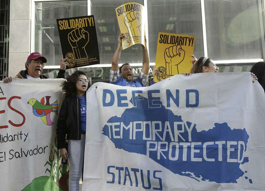 Supporters of temporary protected status immigrants hold signs and cheer at a rally before a news conference announcing a lawsuit against the Trump administration over its decision to end a program that lets immigrants live and work legally in the United States outside of a federal courthouse in San Francisco, Monday, March 12, 2018. Plaintiffs are alleging the decision to end temporary protected status for El Salvador, Haiti, Nicaragua and Sudan was racially motivated. Photo: Jeff Chiu, STF / AP / Copyright 2018 The Associated Press. All rights reserved.