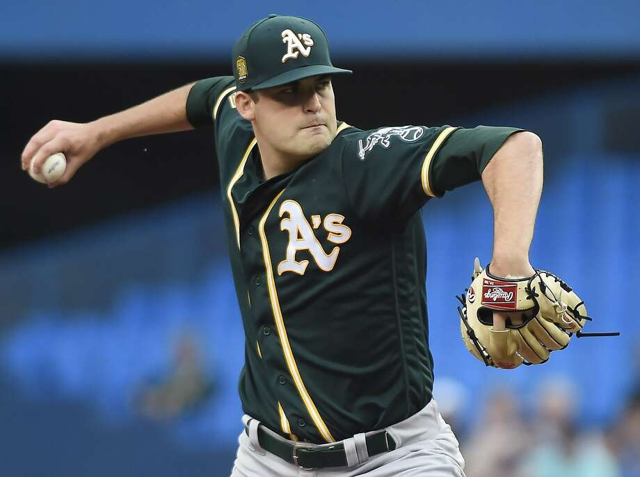 Oakland Athletics starting pitcher Andrew Triggs throws to a Toronto Blue Jays batter during the first inning of a baseball game Thursday, May 17, 2018, in Toronto. (Nathan Denette/The Canadian Press via AP) Photo: Nathan Denette / Associated Press