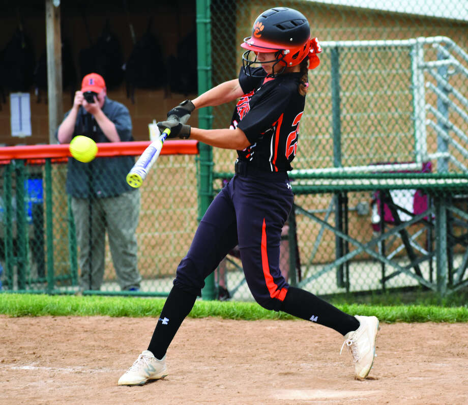 Edwardsville's Jordyn Henricks ropes an RBI single into right center to put the Tigers ahead for good in the third inning of Thursday's game against Collinsville.