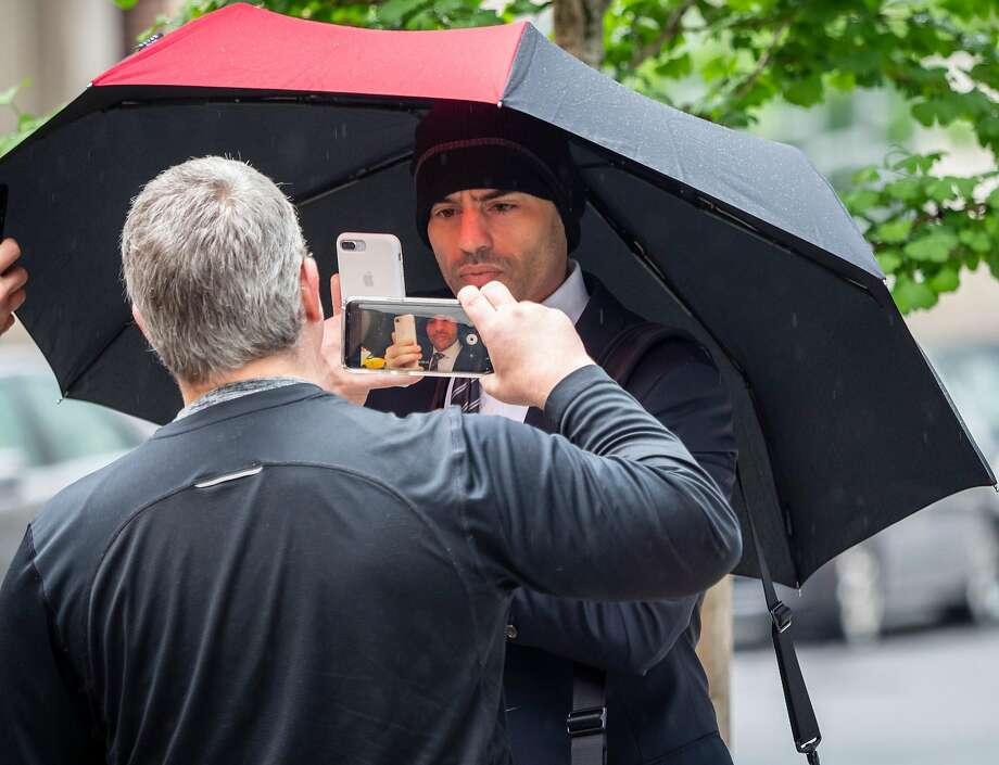 Lawyer Aaron Schlossberg, center, the man who ranted against the people speaking Spanish in a Midtown restaurant, takes a cellphone video of reporters taking his video as he leaves his home in Manhattan, New York on Thursday, May 17, 2018.  (Anthony DelMundo/New York Daily News/TNS) Photo: Anthony DelMundo, TNS