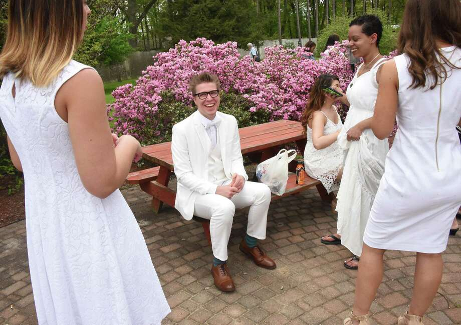 Kyle Carlson of Albany, second from left, smiles as he is surrounded by his classmates before Maria College's traditional white tea ceremony where nursing graduates get their pins at Maria College on Thursday, May 17, 2018 in Albany, N.Y. (Lori Van Buren/Times Union) Photo: Lori Van Buren / 20043790A