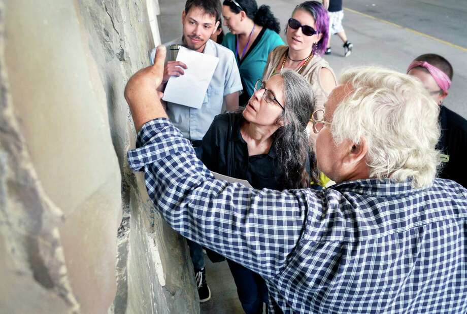 State Paleontologist Emeritus Dr. Ed Landing, right, leads an educational tour of the outside walls of the Cultural Education Center building Thursday May 17, 2018 in Albany, NY.  (John Carl D'Annibale/Times Union) Photo: John Carl D'Annibale / 20043799A
