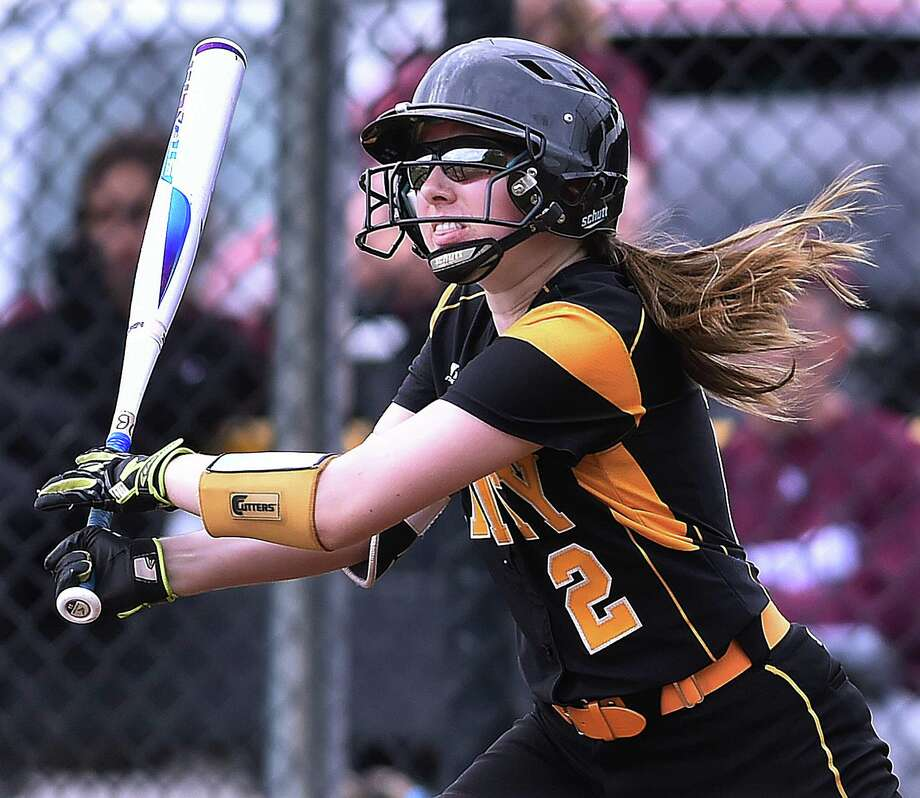 Amity's Elizabeth Brownfield drives in a run during Thursday's game against North Haven. Photo: Catherine Avalone / Hearst Connecticut Media / New Haven Register