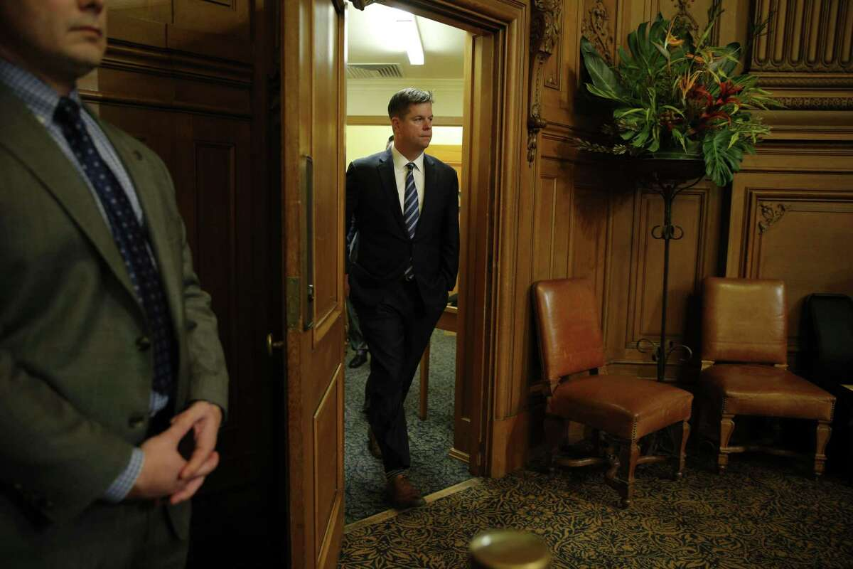 Mark Farrell heads back to a meeting at City Hall in January after being voted interim mayor by the Board of Supervisors.