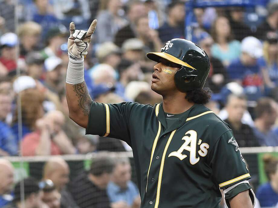 Oakland Athletics designated hitter Khris Davis celebrates his two-run home run against the Toronto Blue Jays during the third inning of a baseball game Thursday, May 17, 2018, in Toronto. (Nathan Denette/The Canadian Press via AP) Photo: Nathan Denette / Associated Press