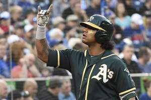 Oakland Athletics designated hitter Khris Davis celebrates his two-run home run against the Toronto Blue Jays during the third inning of a baseball game Thursday, May 17, 2018, in Toronto. (Nathan Denette/The Canadian Press via AP)