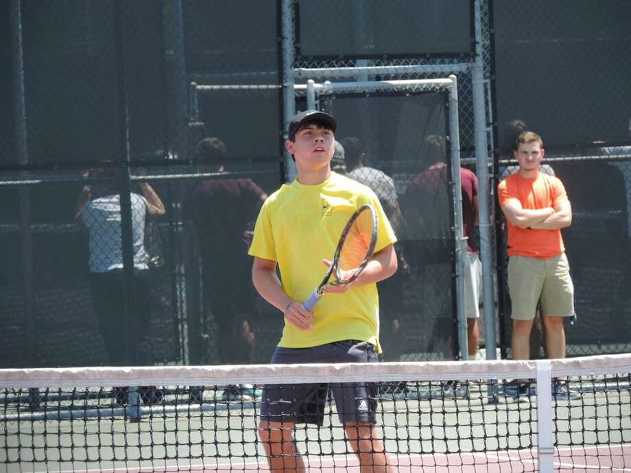 Grady senior Dominic Gibson waits for the ball at the net before his Class 1A boys singles state semifinal match against Slidell's Stone Coston Thursday in College Station. Photo by Christopher Hadorn Reporter-Telegram