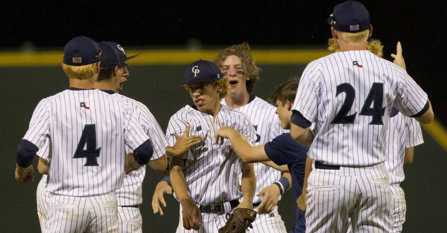 College Park players mob starting pitcher Brandon Garza, center, after defeating Oak Ridge 4-2 in Game 1 of Class 6A Region II quarterfinal series on Thursday, May 17, 2018, in The Woodlands. Photo: Jason Fochtman/Houston Chronicle
