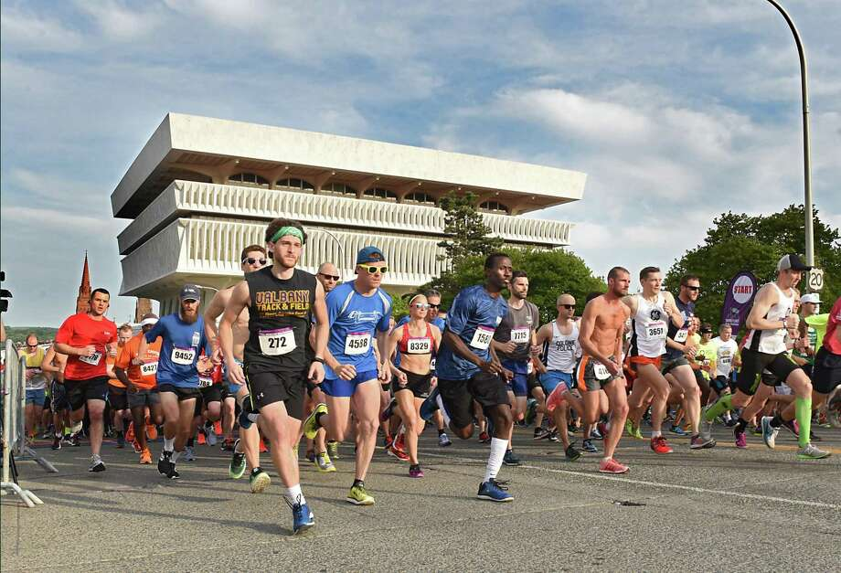 The front of the pack runs up Madison Ave. in the CDPHP Workforce Team Challenge 5K on Thursday, May 17, 2018 in Albany, N.Y. (Lori Van Buren/Times Union) Photo: Lori Van Buren / 20043788A
